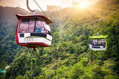 Aerial tramway moving up in tropical jungle mountains Royalty Free Stock Photos