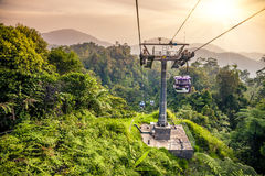 Aerial tramway moving up in tropical jungle mountains Stock Image