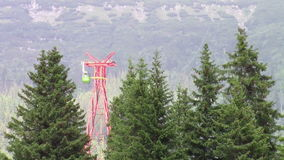 Aerial tramway. With passengers intersecting with the pole of the transportation system stock footage