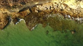 Aerial. Transparent waters on the shores of the sunny Algarve. From above stock video
