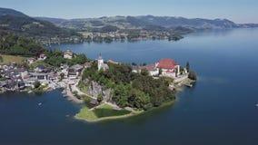 Aerial of Traunkirchen church, Upper Austria. Flight around Traunkirchen church on Traunsee lake, in Salzkammergut, Upper Austria stock video footage