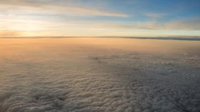 Aerial traveling. Flying at dusk or dawn. Fly through orange cloud and sun stock image