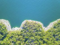 Free Aerial Trees And Cliff Rock Wall Crystal Water At Lake Travis, A Royalty Free Stock Images - 113297409