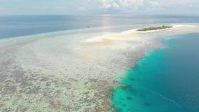 Aerial: tropical atoll view from above, blue lagoon turquoise water coral reef, Wakatobi Marine National Park, Indonesia - concept stock video footage