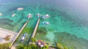 Aerial: Tropical Beach Resort With Boats Parked In The Bay. Drone Shot Of Beautiful Beach Resort With Boats Parked In Moalboal, Cebu stock footage