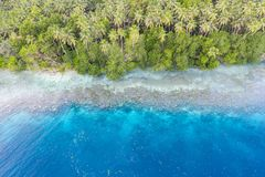 Aerial of Tropical Island Coastline in Papua New Guinea. A bird`s eye view of the remote island of New Ireland in Papua New Guinea shows a beautiful reef and stock photos