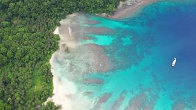 Aerial of Tropical Island, Reef and Lagoon in Papua New Guinea. A bird`s eye view of a beautiful lagoon along New Ireland in Papua New Guinea. This remote area stock video