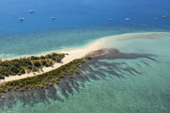 Aerial tropical sand island and reef Royalty Free Stock Photos
