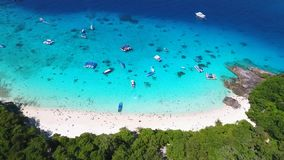 Aerial: Tropical Sandy Princess Beach and Blue Clear Water with Boats and Tourists. HD Slowmotion. Similan, Thailand. stock footage