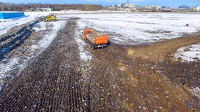 Aerial. Truck at a garbage dump, landfill. Waste site from above. 4K stock footage