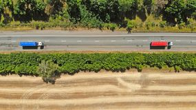 Aerial. Trucks on a highway road. Transport logistics background. Top view.  royalty free stock photos