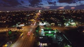 Aerial twilight dusk video over the city stock footage