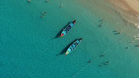 Aerial: Two long tail boats on the beach. Aerial: Two long tail boats on the Kata beach. Thailand. Phuket stock video
