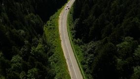 Aerial two white car moving stock video footage
