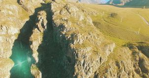 Aerial UHD 4K flight from young hiking man standing on top of the cliff stock video footage