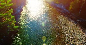 Aerial UHD 4K view. Flight over fresh mountain river. Vertical to horizontal tilt movement. Aerial UHD 4K view. Mid-air flight over fresh mountain river at stock video footage