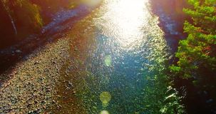 Aerial UHD 4K view. Flight over fresh mountain river. Vertical to horizontal tilt movement. Aerial UHD 4K view. Mid-air flight over fresh mountain river at stock footage