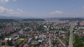 AERIAL: Urban city with houses and green vegetation stock footage