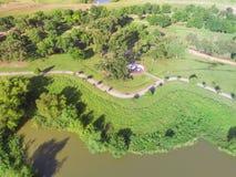 Top view lakeside urban green park with Yin Yang symbol in suburban Houston, Texas, USA stock image