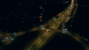 Aerial - Urban traffic at night on a ring road stock video