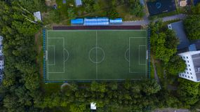 Aerial urban view of the football field with players stock photo