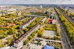 Aerial urban view on 50 let VLKSM street. Tyumen. Tyumen, Russia - September 15, 2015: Aerial view on sleeping neighborhood on VLKSM street with Pond Duck in Stock Photos