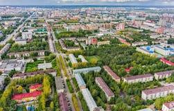 Aerial urban view on Rizhskaya street. Tyumen. Tyumen, Russia - August 25, 2015: Aerial view on sleeping neighborhood large-panel houses, so called KPD Stock Images
