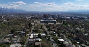 Aerial of Utah's state capitol building overlooking downtown Salt Lake City. Sitting high on the hill above downtown Salt Lake City, Utah's capitol building stock video