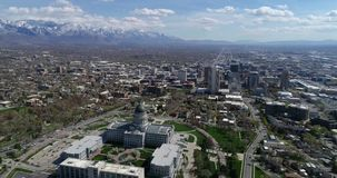 Aerial of Utah's state capitol building overlooking downtown Salt Lake City. Sitting high on the hill above downtown Salt Lake City, Utah's capitol building stock footage