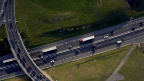 AERIAL, vertical: Road transport, people travelling with cars on a freeway stock video