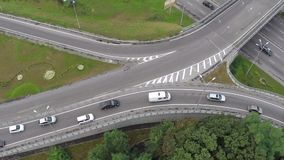 Aerial vertical view of car traffic driving busy city freeway. Stock footage stock video footage