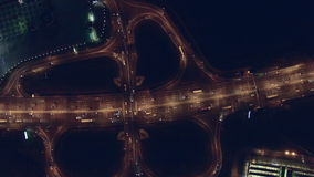 Aerial vertical view at night of city traffic stock video footage