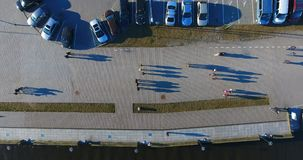 Aerial VERTICAL view of sea pier, long shadows from above