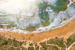 Aerial vew From fying drone view of the wild beach with sunbathers resting people stock photos