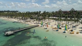 Aerial video of Bavaro Beach resort in Punta Cana, Dominican Republic. Summer holidays and water sports stock video