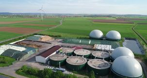 Aerial video of Biogas plant, alternative energy sources, renewable energy. Camera flight over biogas plant from pig farm. Renewable energy from biomass. Modern stock footage