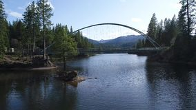 Aerial video of a bridge crossing a lake stock video