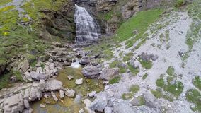 Aerial video Cascada Cola de Caballo waterfall under Monte Perdido at Ordesa Valley Aragon Huesca Pyrenees of Spain Stock Photos