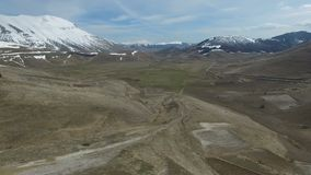 Aerial Video Castelluccio Umbria, Italy in early Spring. The plains and mountain tops of Castelluccio Umbria Italy in the early spring with snow still on the stock video