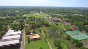 Aerial video college university campus. Aerial drone tour of a college in Tallahassee FL USA stock footage