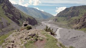 Aerial video of Dariali Gorge near Russia Georgian borders. Road goes through Caucasian mountains. Impressive view on. Caucasus. Terek river flows below. Filmed stock photography