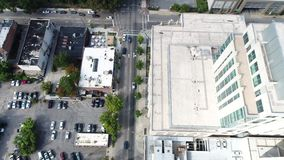 Aerial View by Drone of Rooftops, Parking Lots and Skyline of Raleigh, NC stock video footage