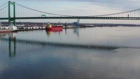 Aerial video flying low on the Delaware river towards Walt Whitman Bridge Philadelphia.  stock video