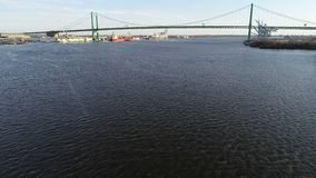 Aerial Video Flying Low on the Delaware River Towards Walt Whitman Bridge Philadelphia.  stock footage