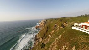 Aerial video footage of Azenhas do Mar, located on the cliffs near Sintra, Portugal. stock video