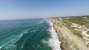 Aerial video footage of Azenhas do Mar, located on the cliffs near Sintra, Portugal. stock footage