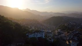 Aerial video footage of city Rio de Janeiro Brazil. narrow streets of the poor favelas house on the hills. Beautiful. Sunset backlight stock video footage