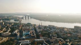 Aerial Video footage Kiev Kyiv Ukraine. Podil historical city center. Down town. River and bridge. Sunrise backlight stock footage