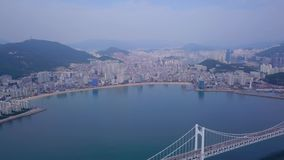Aerial video of Gwangan bridge and Gwangalli beach in Busan, South Korea. stock video footage