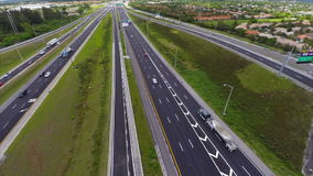 Aerial video of a highway with cars in motion 3 Stock Photos
